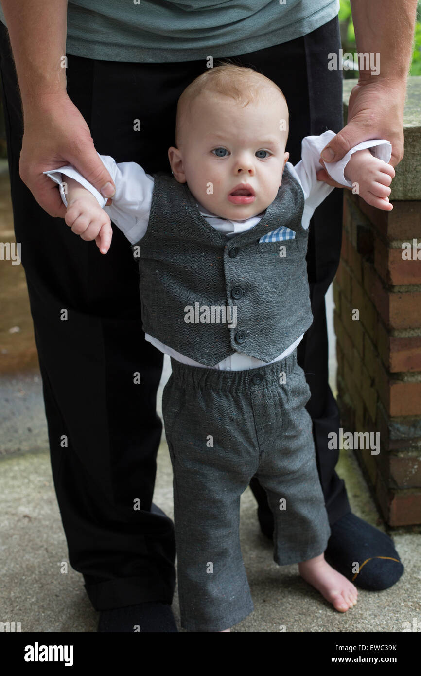 Detroit, Michigan - Adam Hjermstad Jr., 11 months old, is dressed up to attend a wedding. - Stock Image