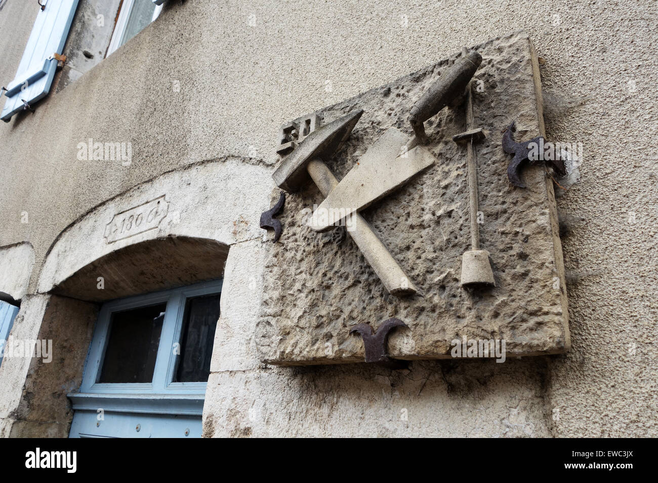Sign depicting tradesmans builders skilled workers house in Bligny-sur-Ouche Burgundy France French - Stock Image
