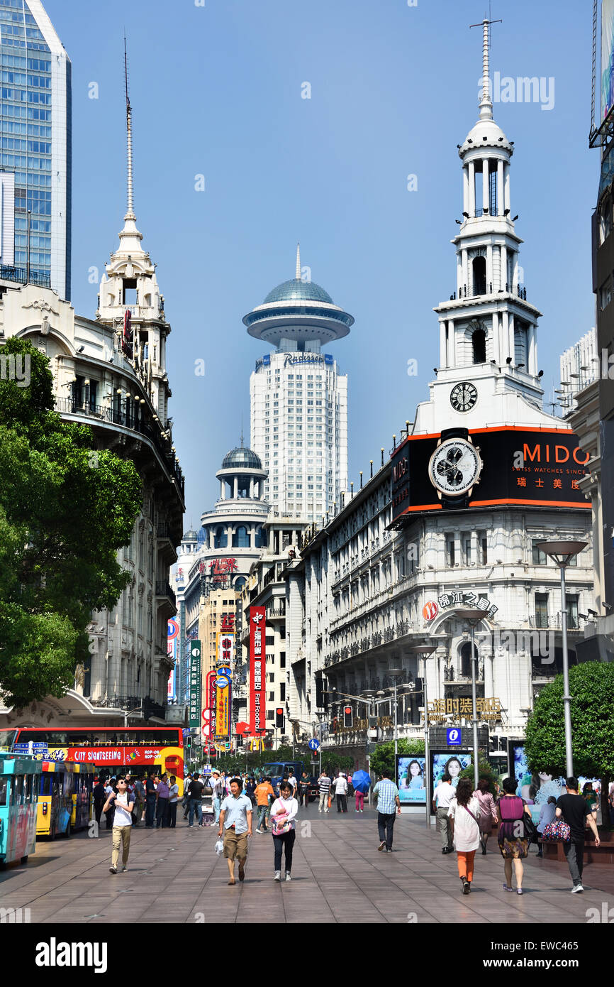 Visitors at Nanjing Road. Main shopping street of Shanghai. One of the busiest shopping streets in the world . East - Stock Image