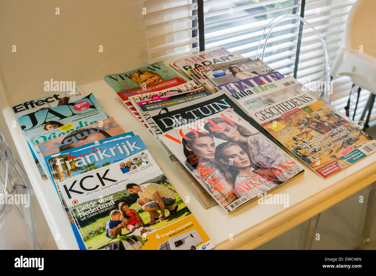 Dutch magazines on a table in a hotel. - Stock Image