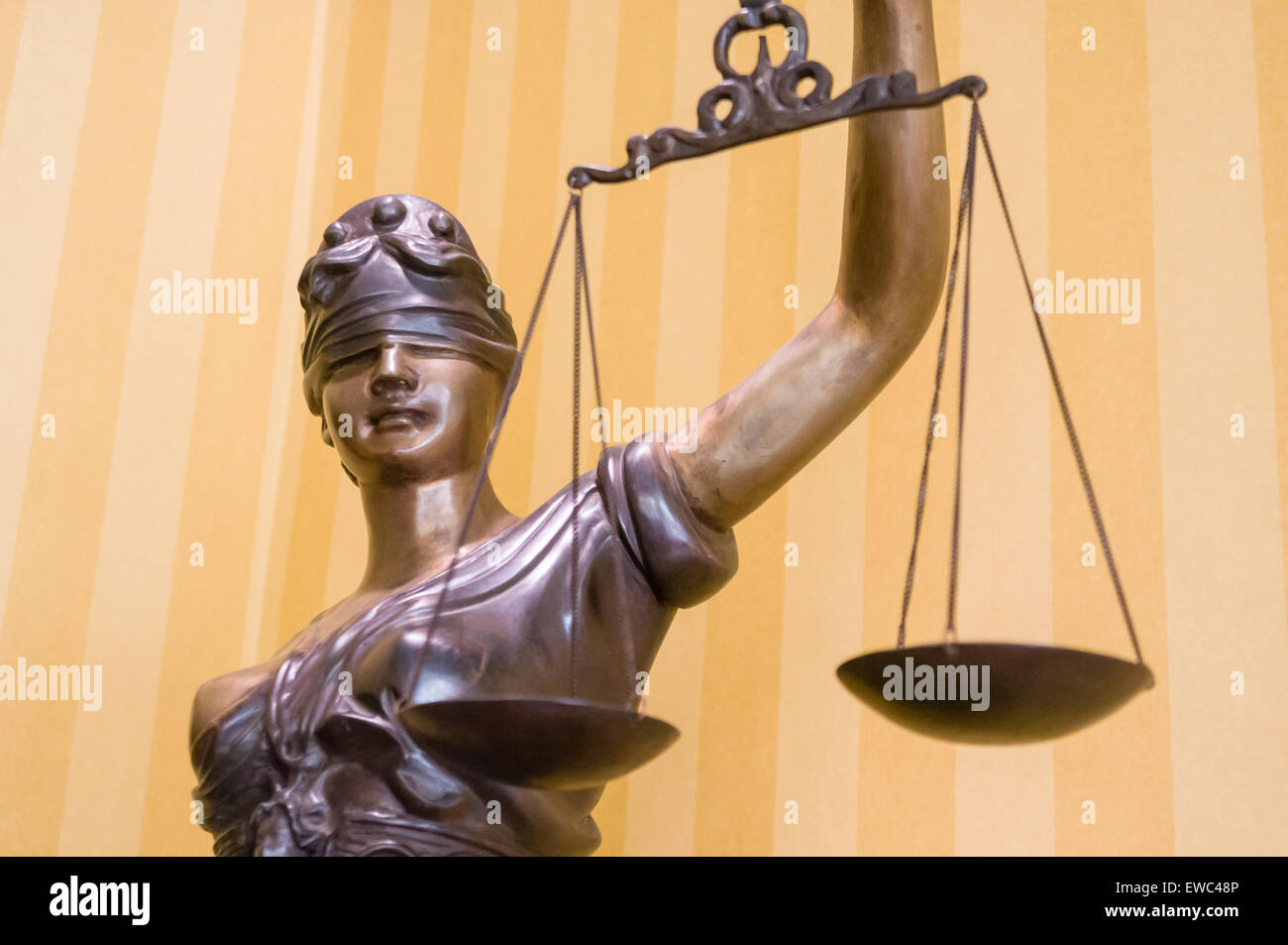 Bronze statue of 'Lady Justice', blindfolded and holding a pair of scales - Stock Image