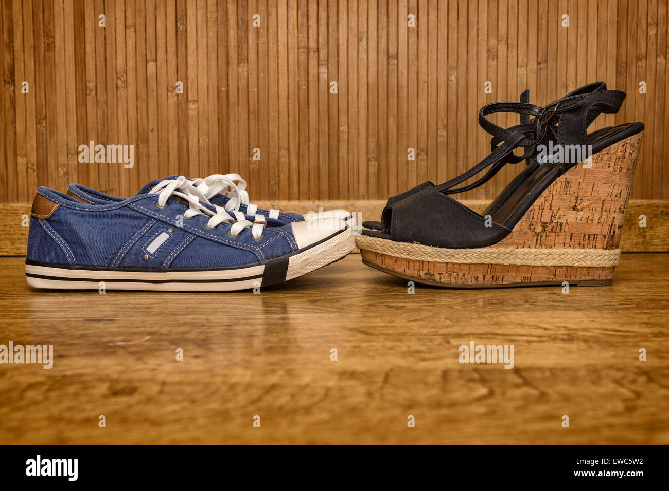 Choice of shoes - sneakers or sandals with high heels - Stock Image