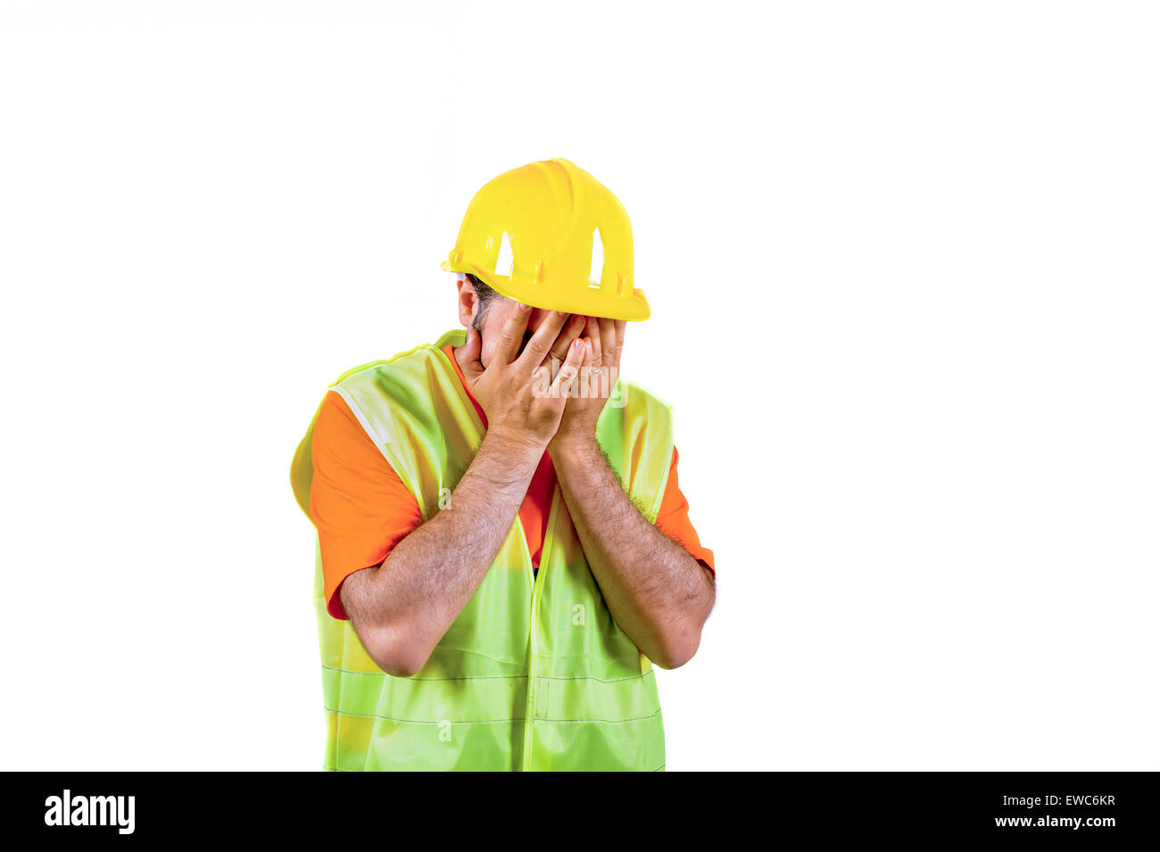 failure sadness guilty Manuel worker regretful isolated on white portrait - Stock Image