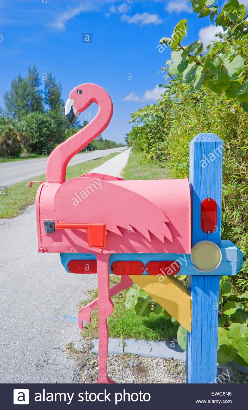 Flamingo made of wood attached to pink mailbox, Sanibel Island, Florida, USA - Stock Image