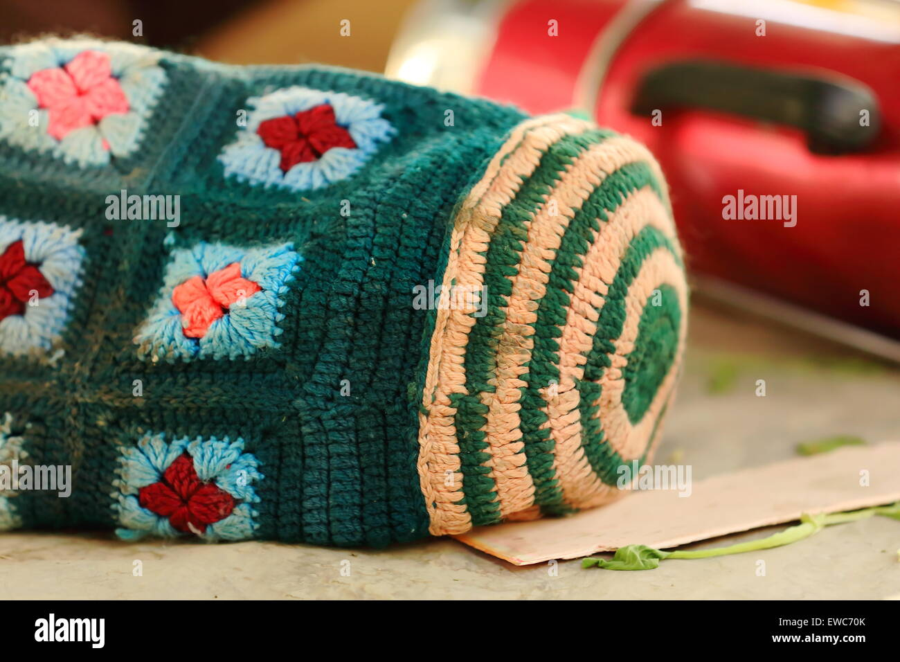 Hand made woolen bag for transporting thermos. Market stall in the lower area of town-Gyantse city and cty.-Shigatse - Stock Image