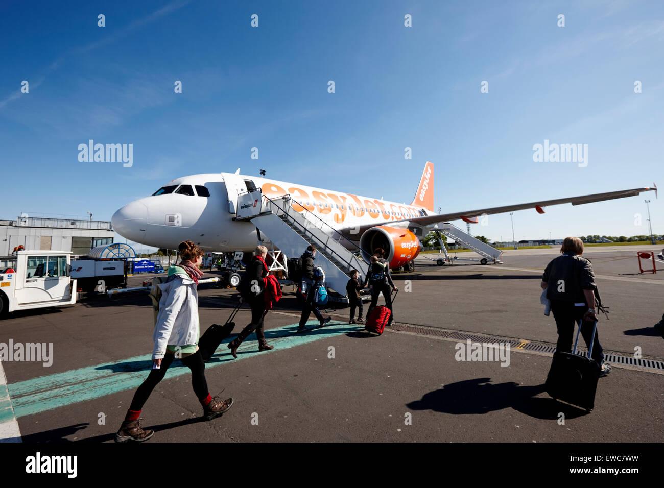 passengers boarding an easyjet aircraft at Belfast International Airport UK - Stock Image