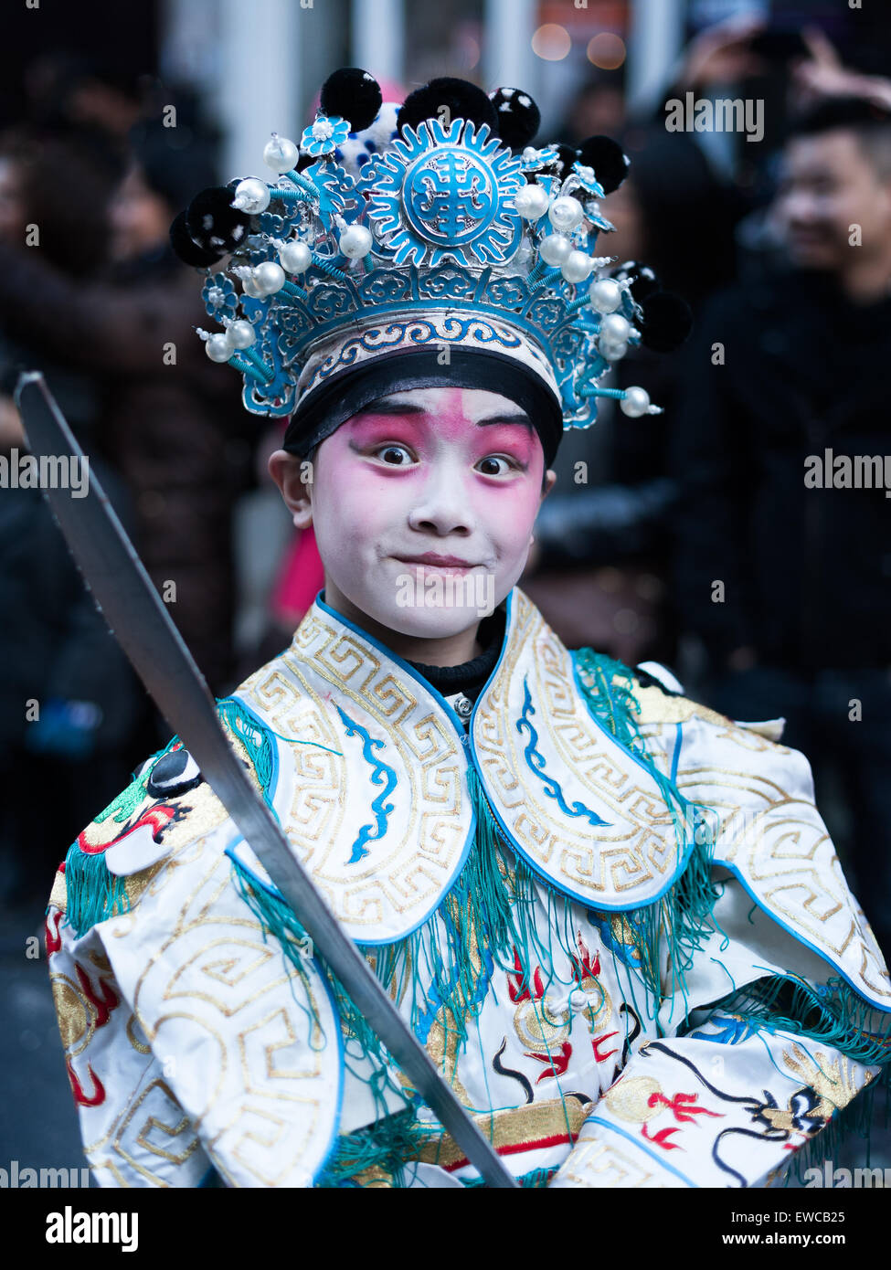 Paris, France - Feb 02, 2014: Chinese young man performs in traditional costume at the chinese lunar new year parade. Stock Photo