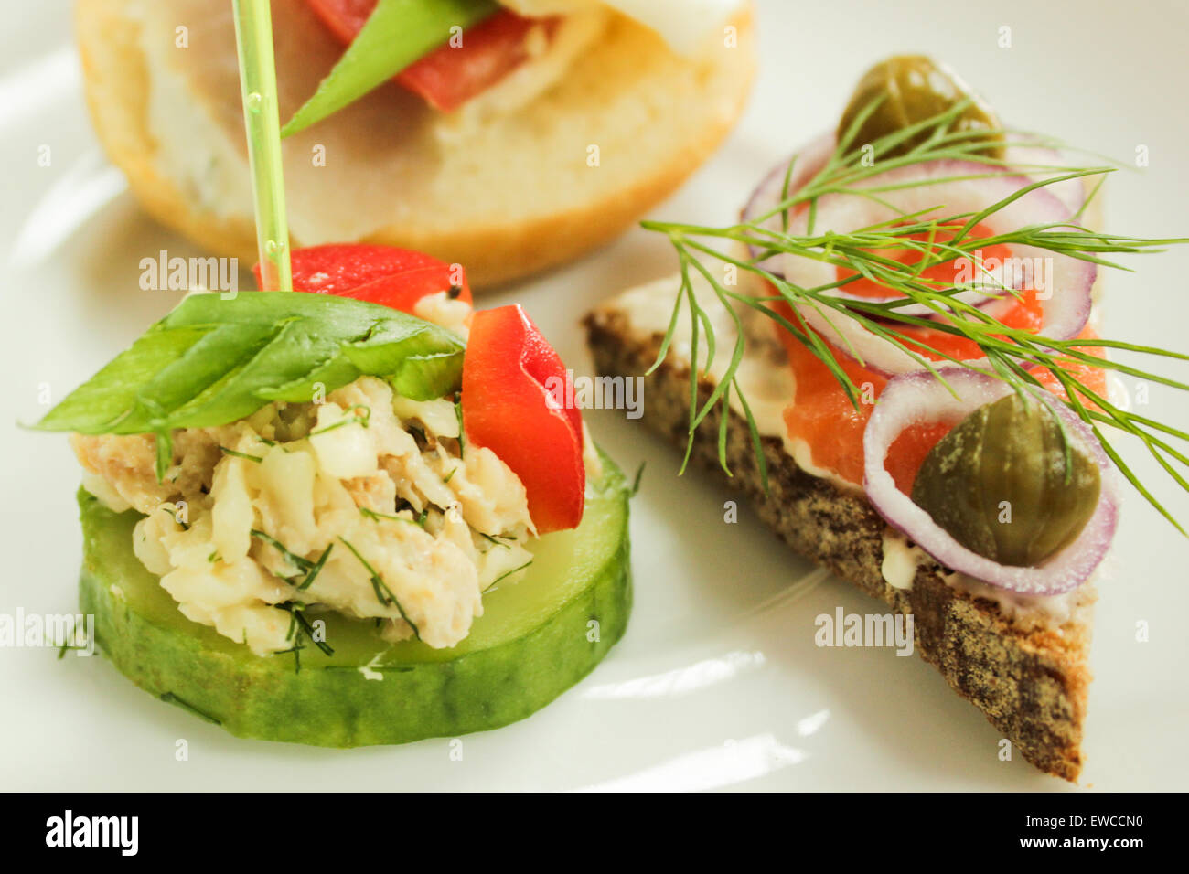 Mini canapes - Colorful fresh snacks on the white plate. - Stock Image