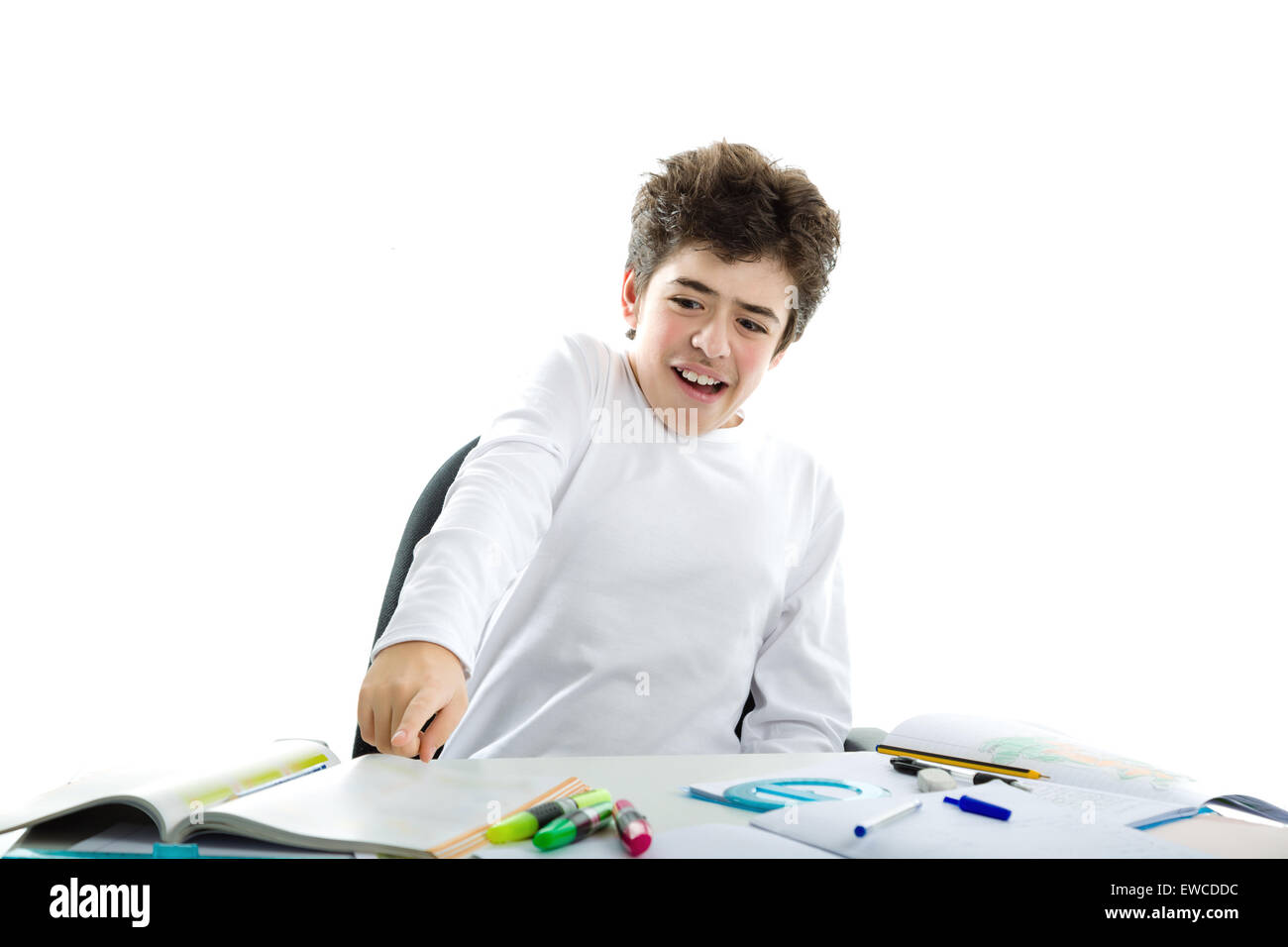 Panicky Caucasian smooth-skinned boy wearing a white long sleeve t-shirt is pointing to homework Stock Photo