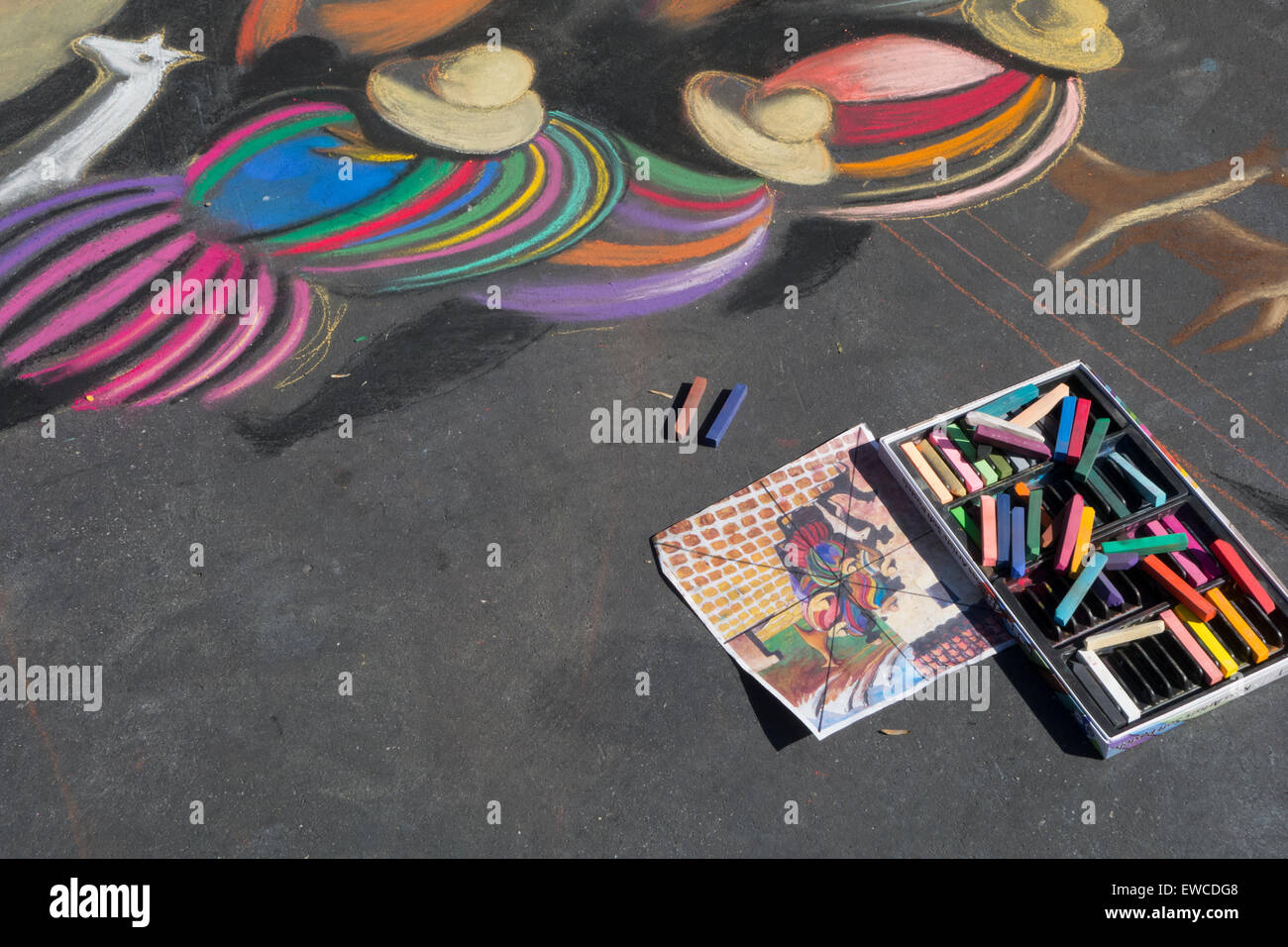 chalk painting on sidewalk at I Madonnari Festival in front of historic old Mission Santa Barbara Central California - Stock Image
