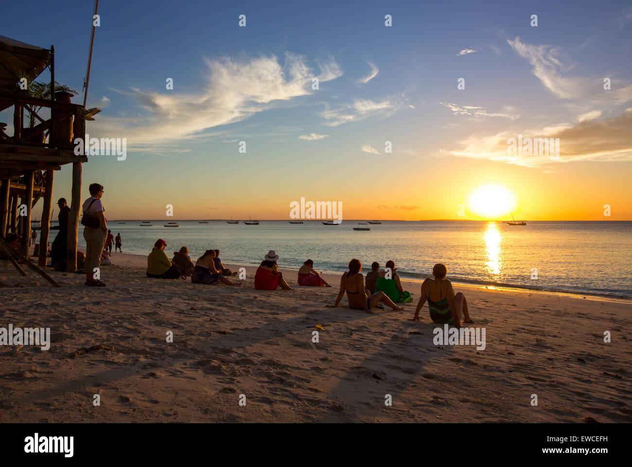 Tourists Watch The Sunset On Nungwi Beach Zanzibar