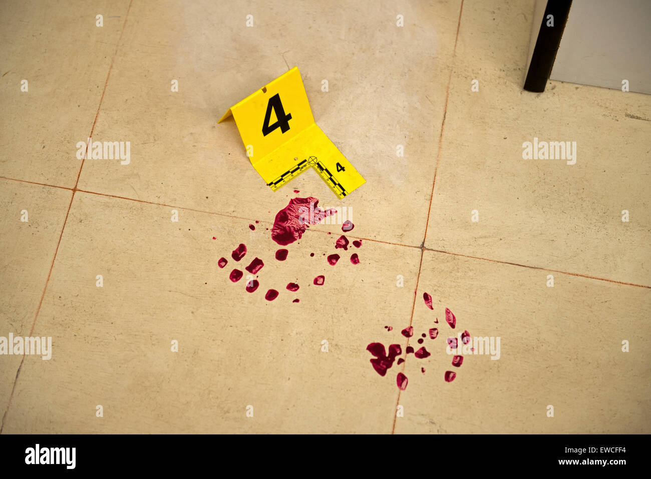 Evidence marker and blood on floor - Stock Image