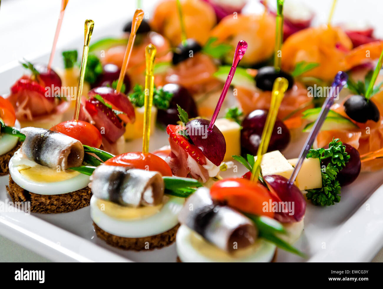Seafood and meat canapes - Stock Image