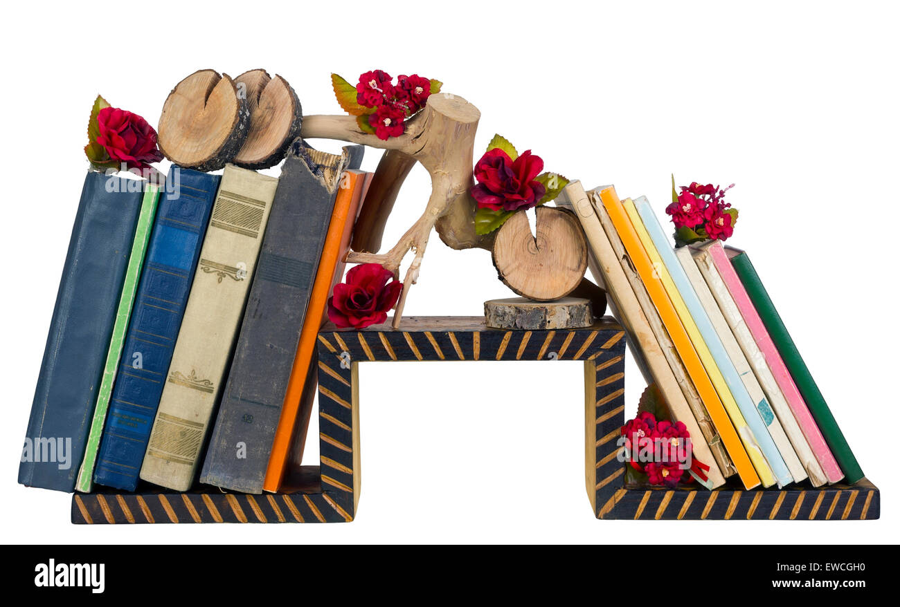 Rural nasty taste - a self-made wooden book shelf with decrepit paper volumes and installations. Isolated - Stock Image