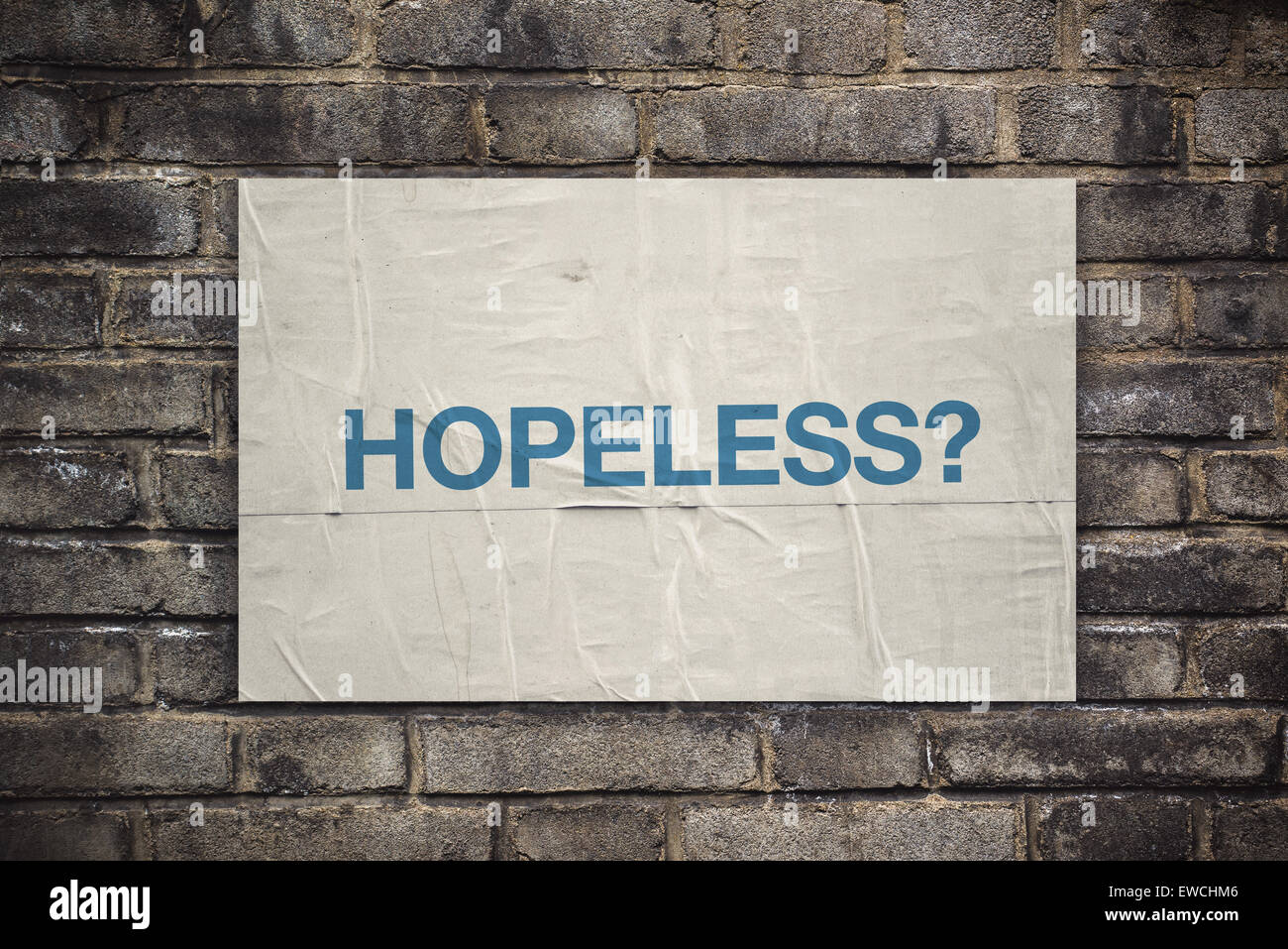 Hopeless on Rustic Poster Paper Glued to Old Brick Wall, Retro Toned Vintage Effect - Stock Image