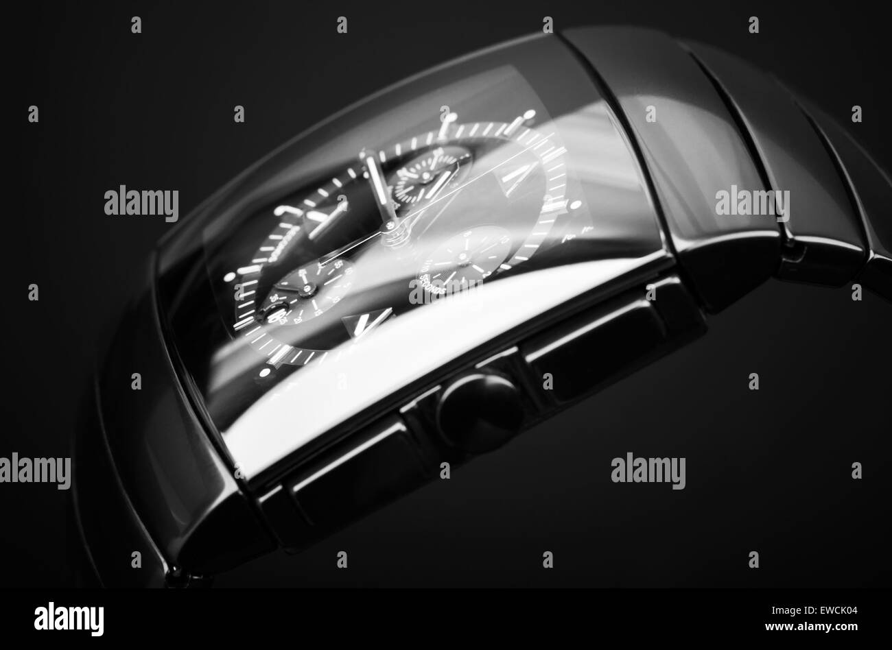 Luxury mens chronograph watch made of black high-tech ceramics on black background. Closeup studio photo with selective - Stock Image
