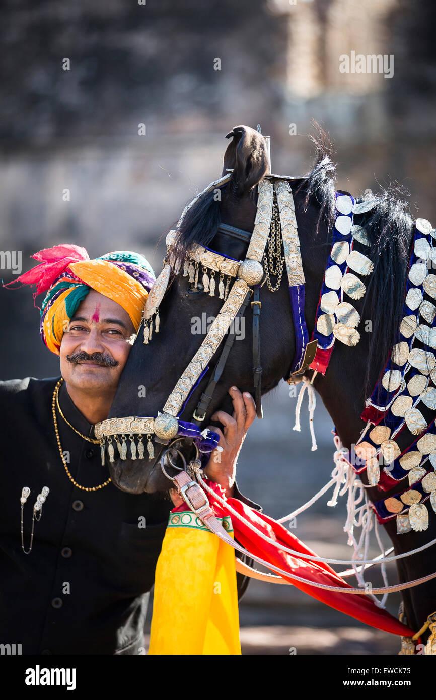 Marwari Horse. Black dancing horse with its proud owner. Rajasthan, India - Stock Image