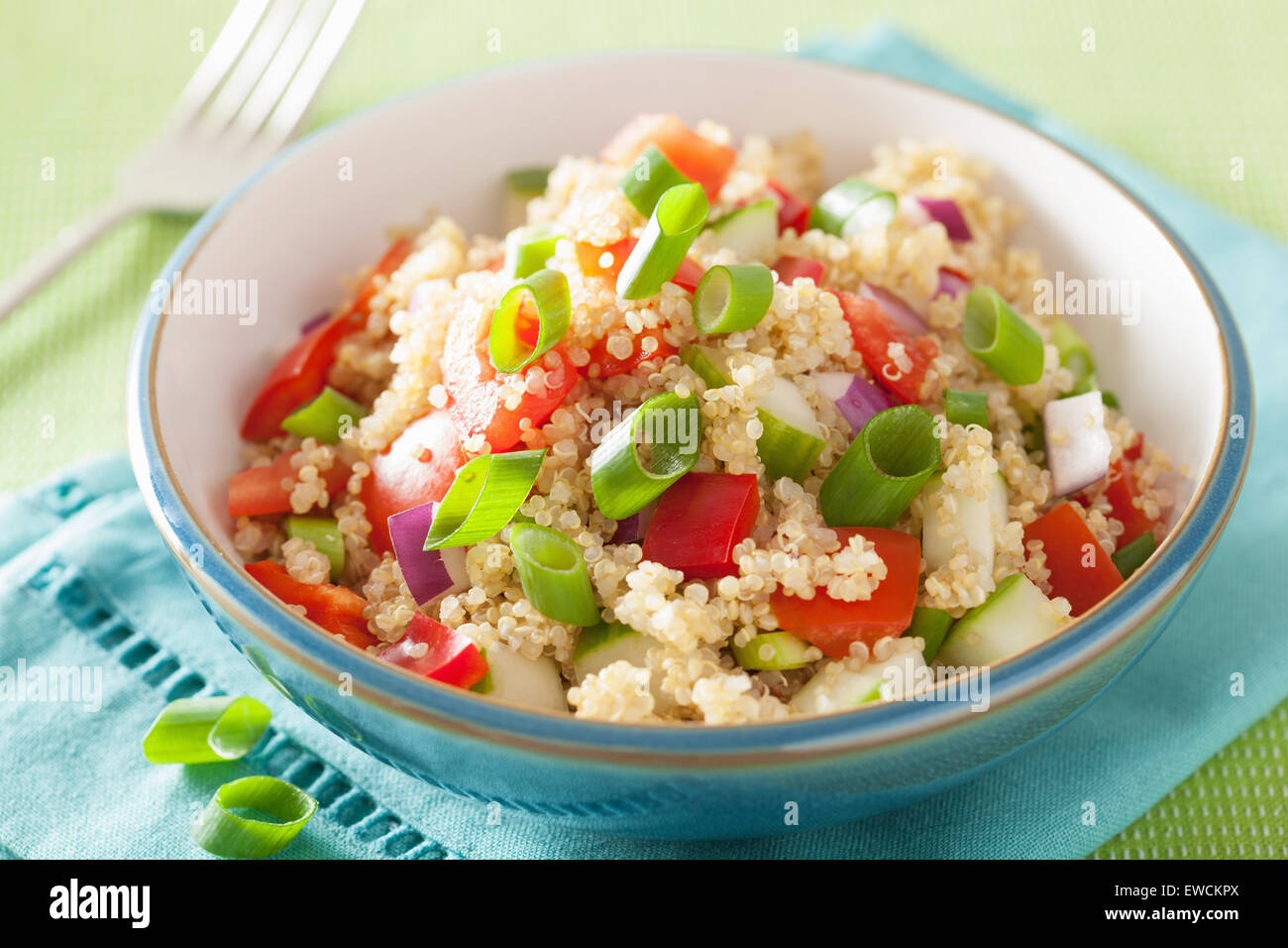 healthy quinoa salad with tomato cucumber onion chives - Stock Image