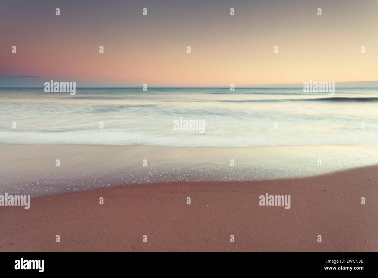 Minimal seascape at dusk - Stock Image