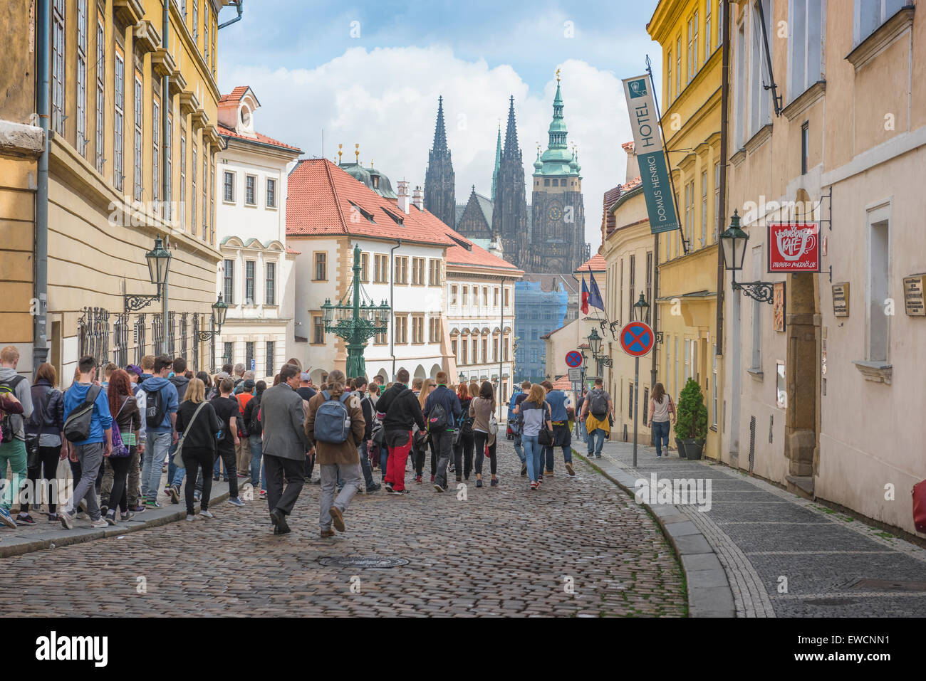 Prague Hradcany, along Uvoz in the Hradcany district of Prague a group of tourists head for the landmark St. Vitus Cathedral, Czech Republic. Stock Photo