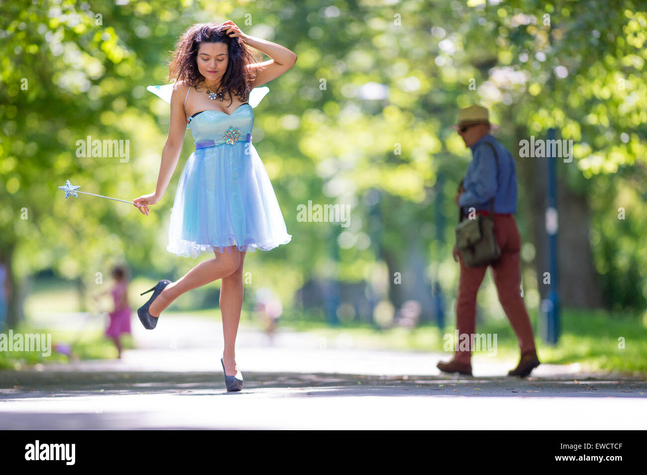 Aberystwyth, Wales, UK. 23rd June, 2015.  20 year old MONET MITCHELL tries out her fairy powers on a sunny afternoon - Stock Image