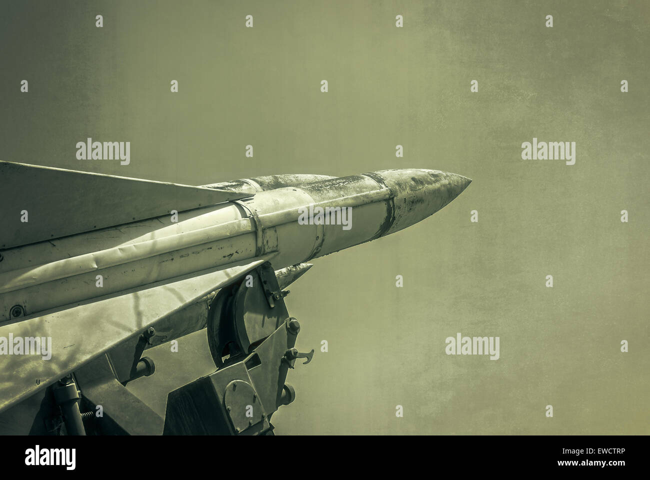 Old russian antiaircraft defense rocket launcher missiles. Grunge Army Missile.  Photo textured in old color image - Stock Image