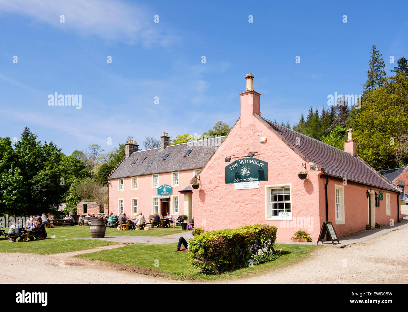 People dining outside the Wineport bar and bistro restaurant near Brodick, Isle of Arran, North Ayrshire, Scotland, - Stock Image