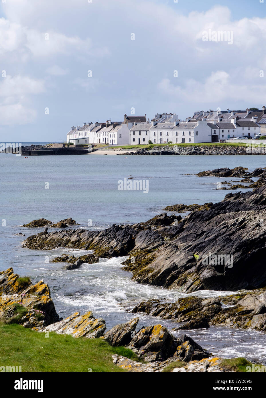 View along Scottish island rocky coast of Loch Indaal to Port Charlotte Isle of Islay Western Isles Inner Hebrides - Stock Image