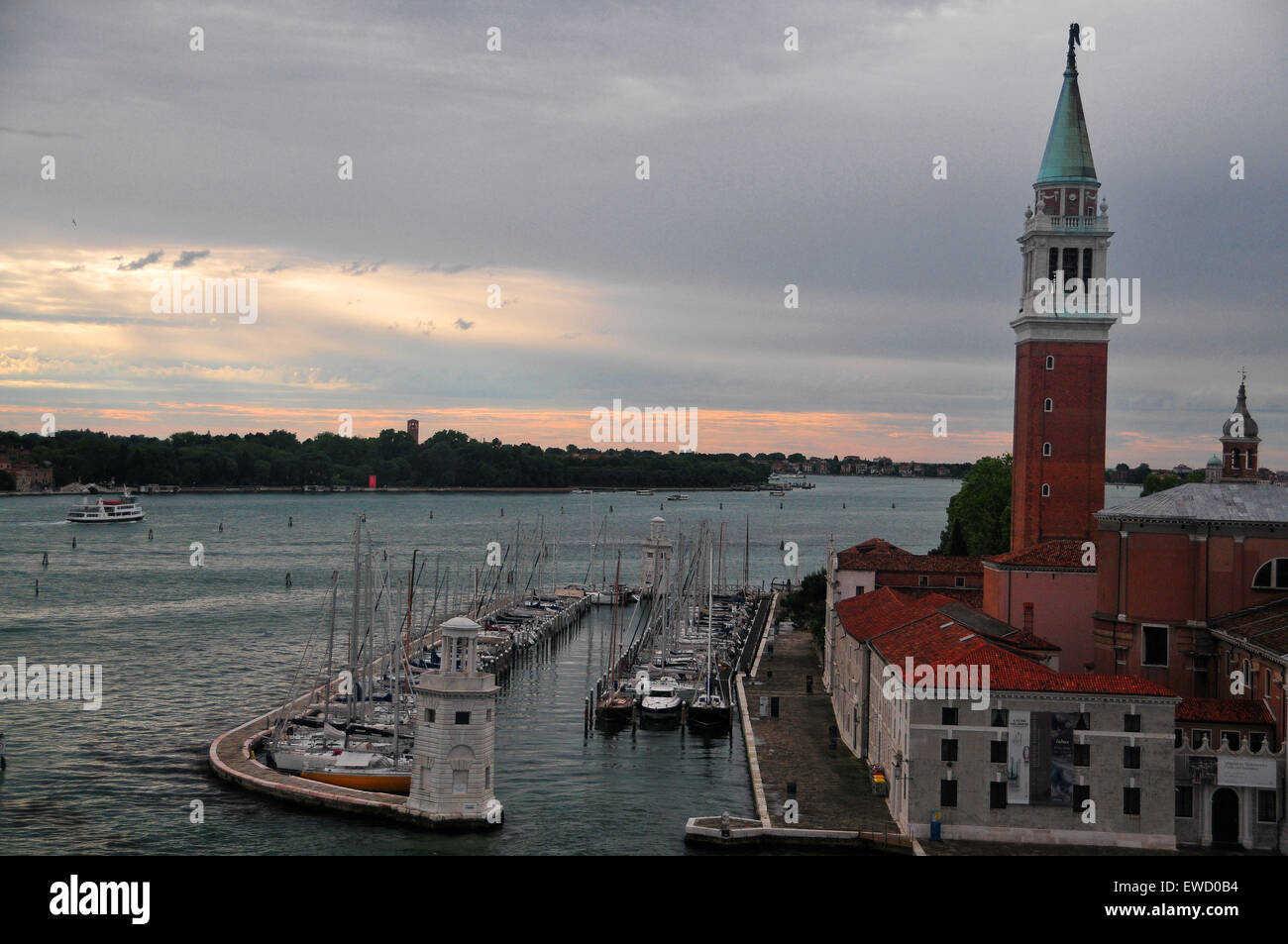 There are many popular sites to see along Venice Italy's canals and harbors such as San Giorgio Basilica. - Stock Image