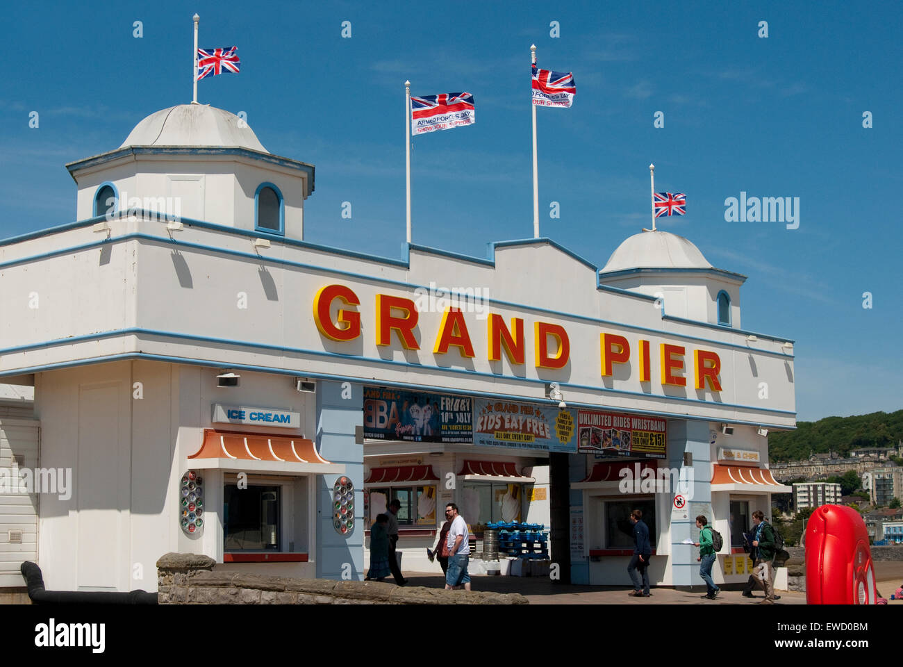 Editorial image of the Grand Pier Weston Super-Mare against blue summer skies and bathed in glorious sunshine - Stock Image