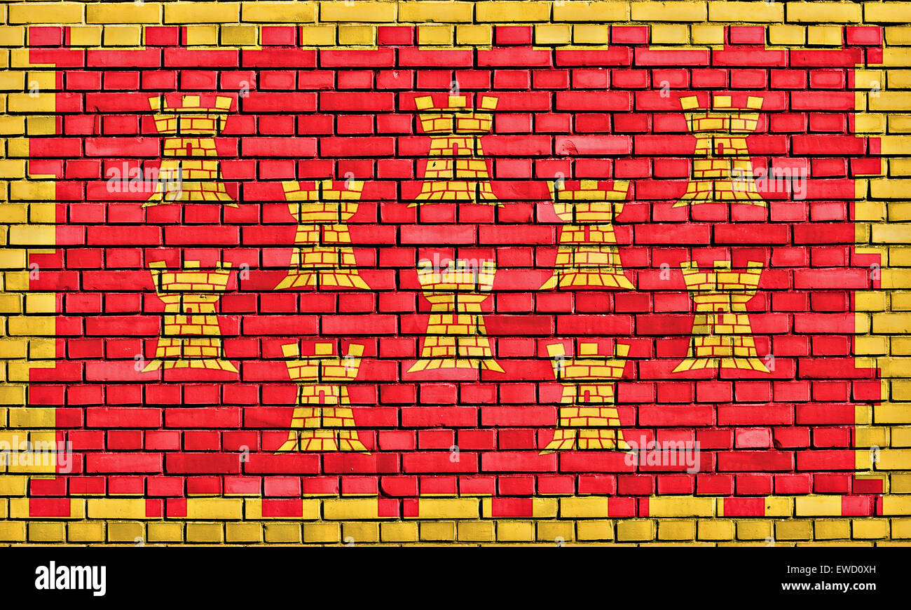 flag of Greater Manchester painted on brick wall - Stock Image