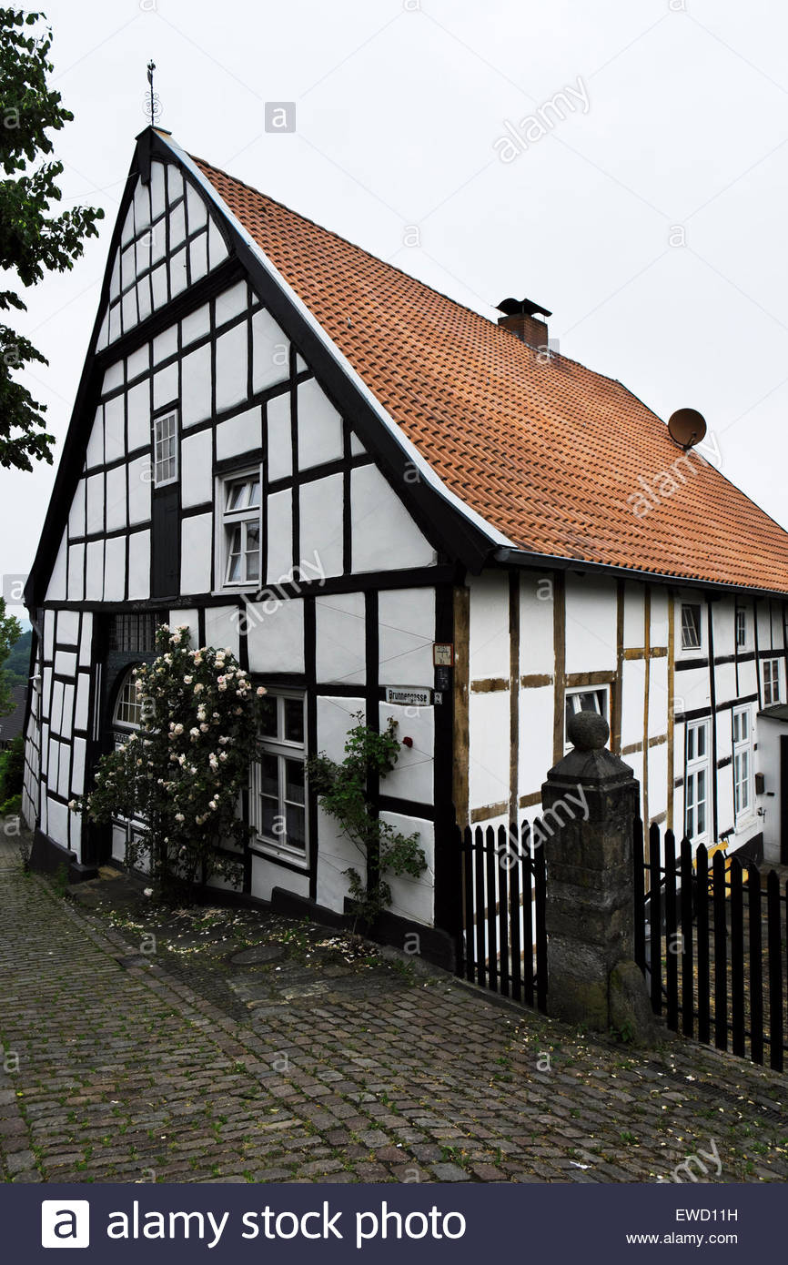 A post-and-beam house in Tecklenburg, Germany, has inscription above door which shows it as constructed 1669, renovated - Stock Image