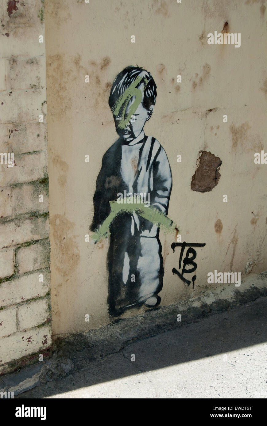 Editorial image of Urban artwork of a small boy possibly by