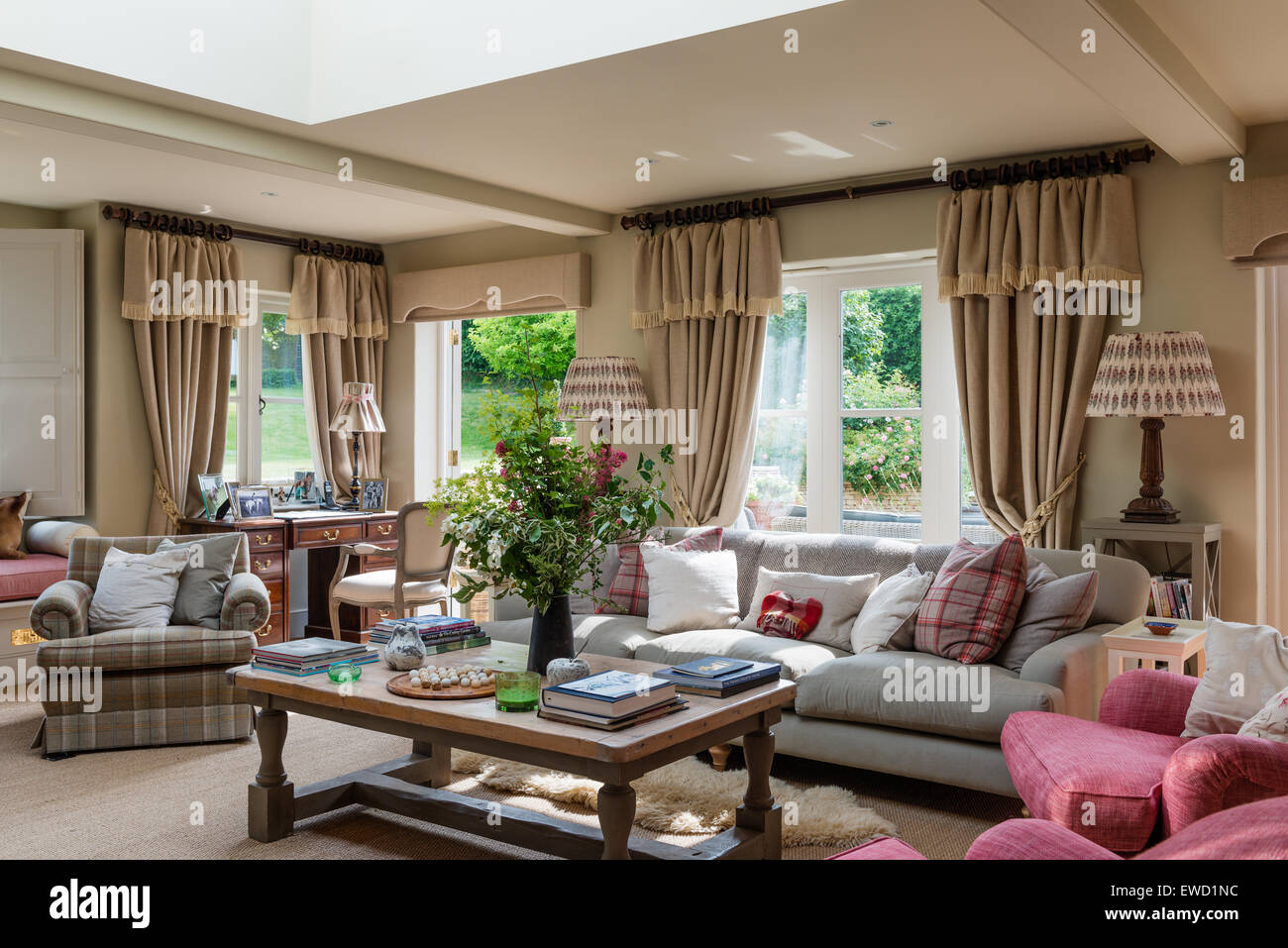 Sitting room with low coffee table and sofa and armchairs upholstered in Robert Kime fabrics. - Stock Image