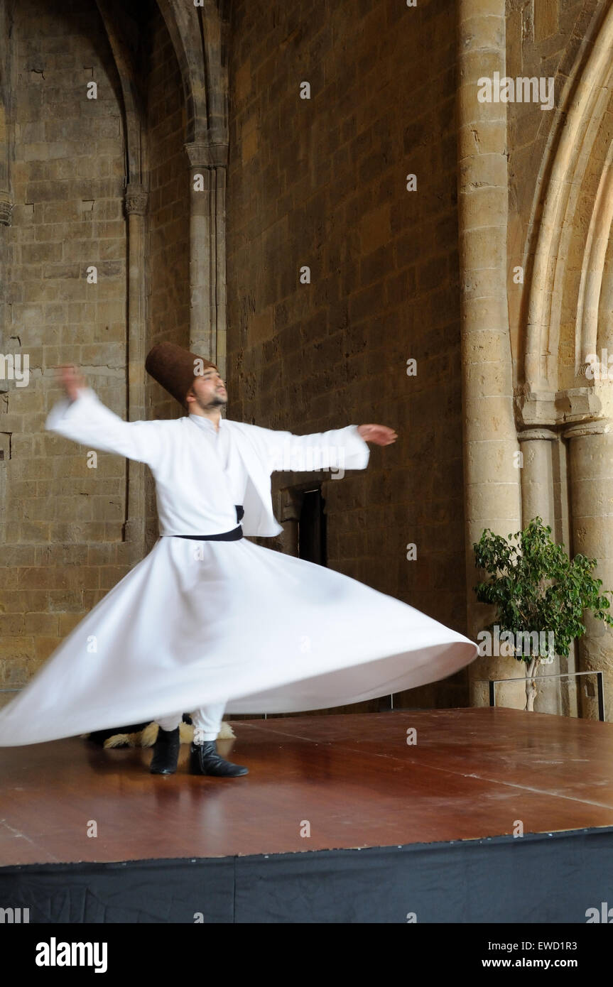 Whirling Dervish performance Selimiye Square  Nicosia North Cyprus - Stock Image