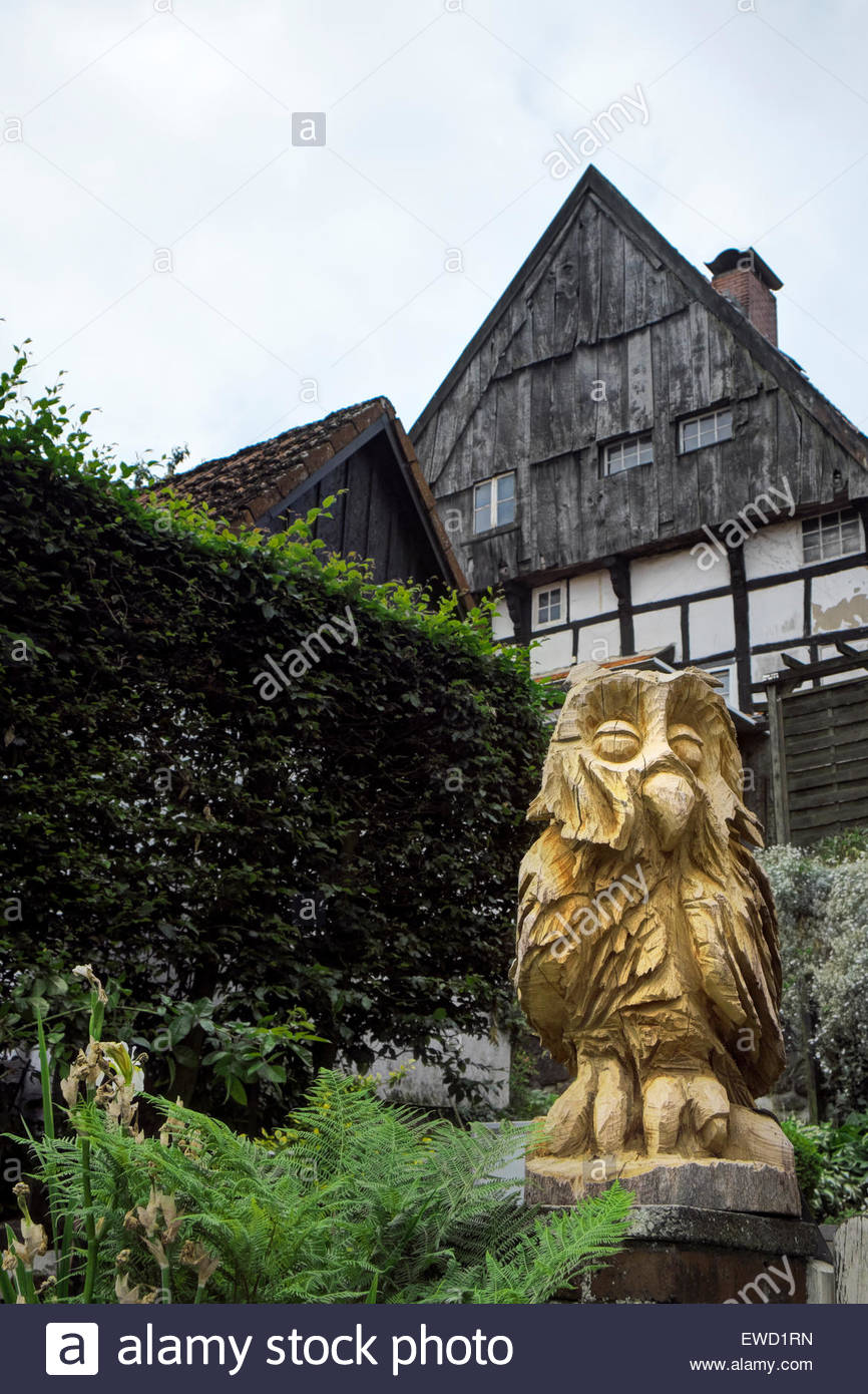 Post-and-beam house in Tecklenburg, Germany, has wood carving of an owl relating to the Hexenpfad, or Witches Path - Stock Image