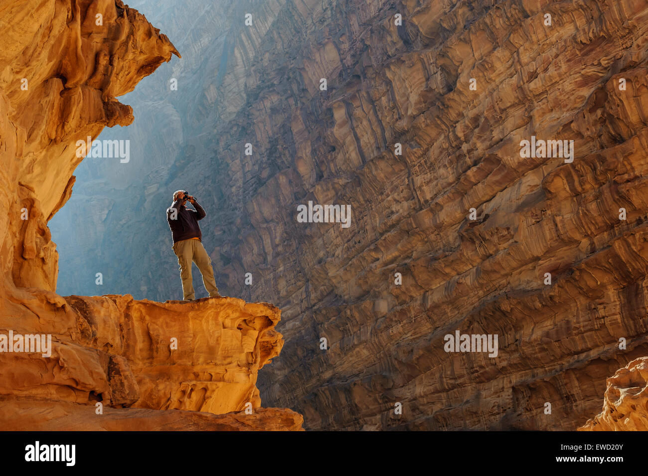 A local guide enjoys the view in Wadi Rum (The Valley Of The Moon), Jordan, Middle East - Stock Image