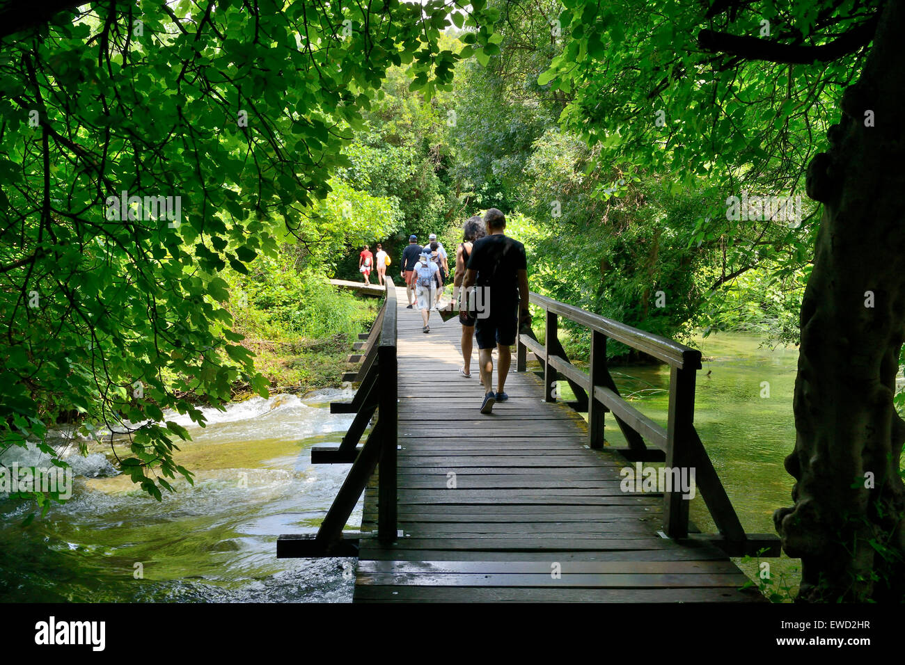 Tourists on boardwalk at Skradinski Buk waterfalls, Krka National Park on Dalmatian Coast of Croatia Stock Photo