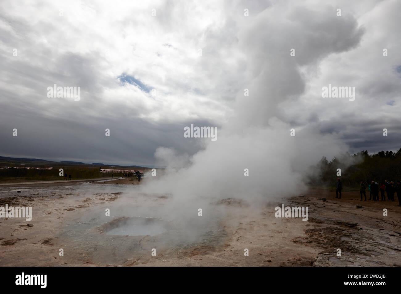 strokkur geyser erupting at geyser geothermal site Geysir Iceland - Stock Image