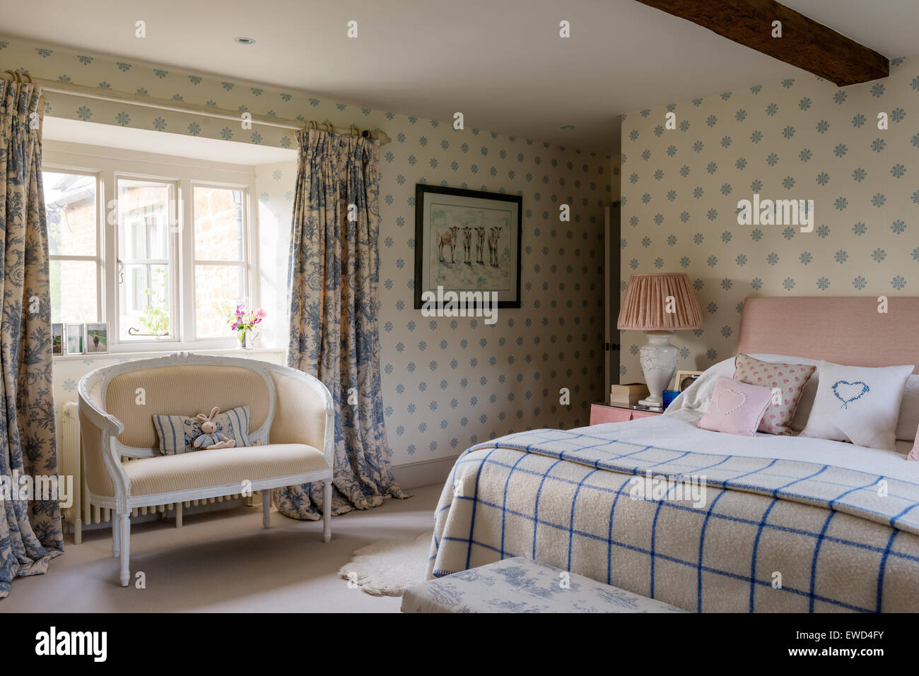 . Kate Forman French style fabrics in guest bedroom with patterned
