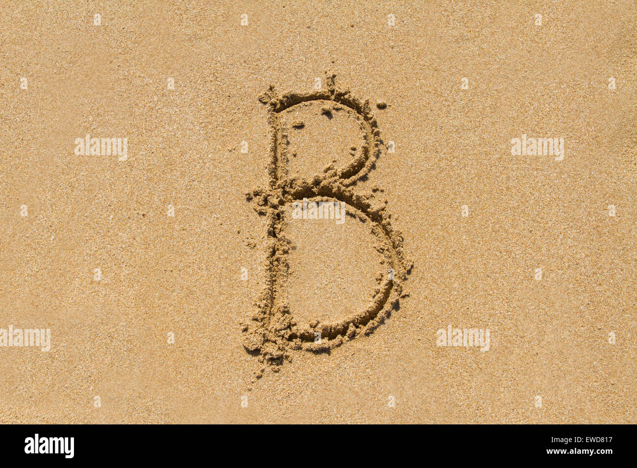 Letter B of the alphabet written on sand with upper case. - Stock Image