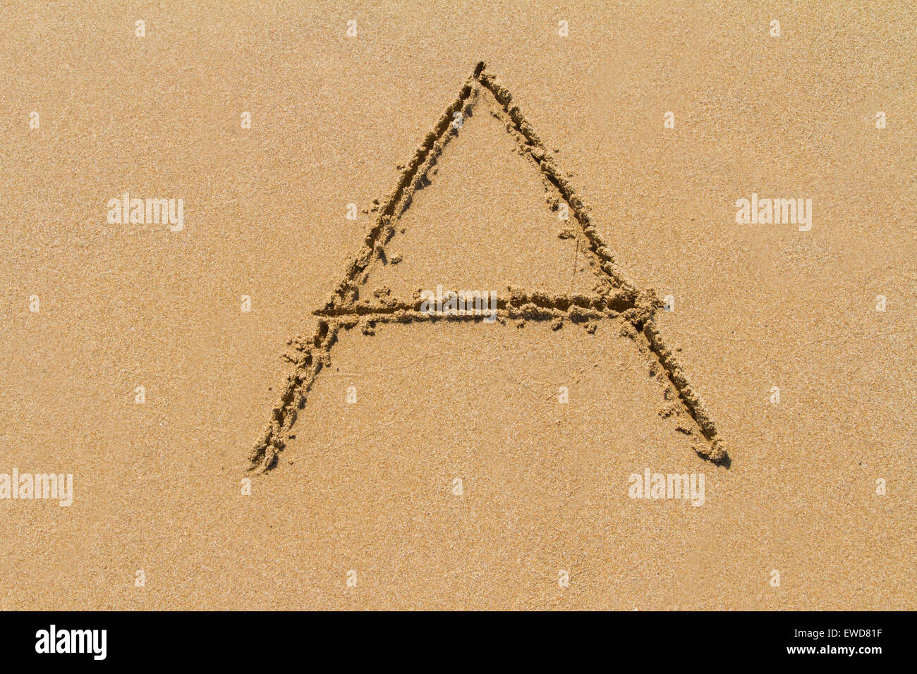 Letter A of the alphabet written on sand with upper case. - Stock Image
