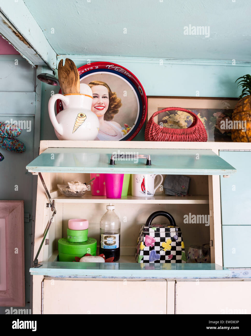 Selection of crockery in retro style cabinet - Stock Image