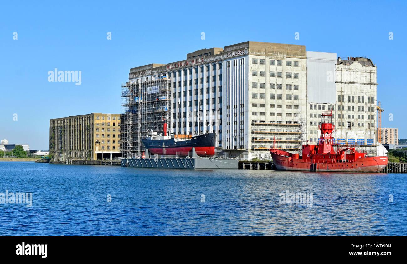 Royal Docks London Ex Trinity House Lightvessel 93 & SS Robin steam coaster on pontoon Royal Victoria Dock & - Stock Image