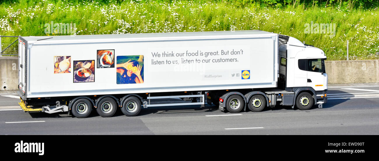 Lidl DHL logistics food supply chain hgv truck lorry with articulated delivery trailer & advertising driving - Stock Image