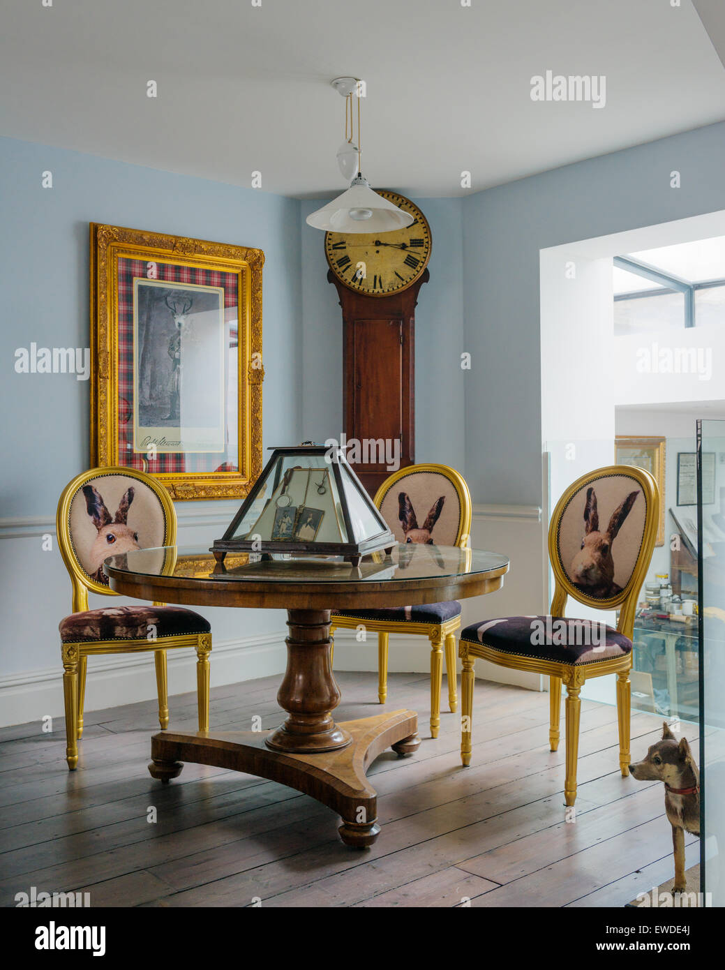 Three Gilt Dining Chairs Covered In Cory Visitorian Hare Head Fabric Round  Circular Table In Room With Antique Clock