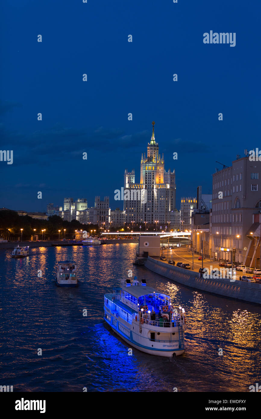 Kotelnicheskaya Embankment Building, one of the Stalinist-era 'Seven Sisters,' towers over boats on the - Stock Image