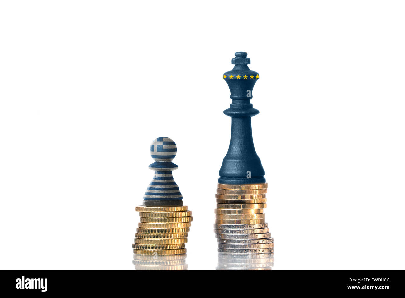 Chess pieces on a stack of coins in the Colors of Greece and the EU - Stock Image