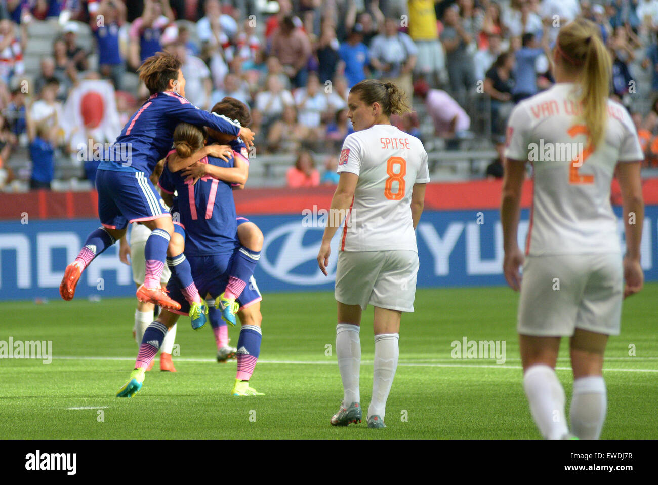 Vancouver, Canada. 23rd June, 2015. Players of Japan celebrate scoring against the Netherlands during their Round - Stock Image