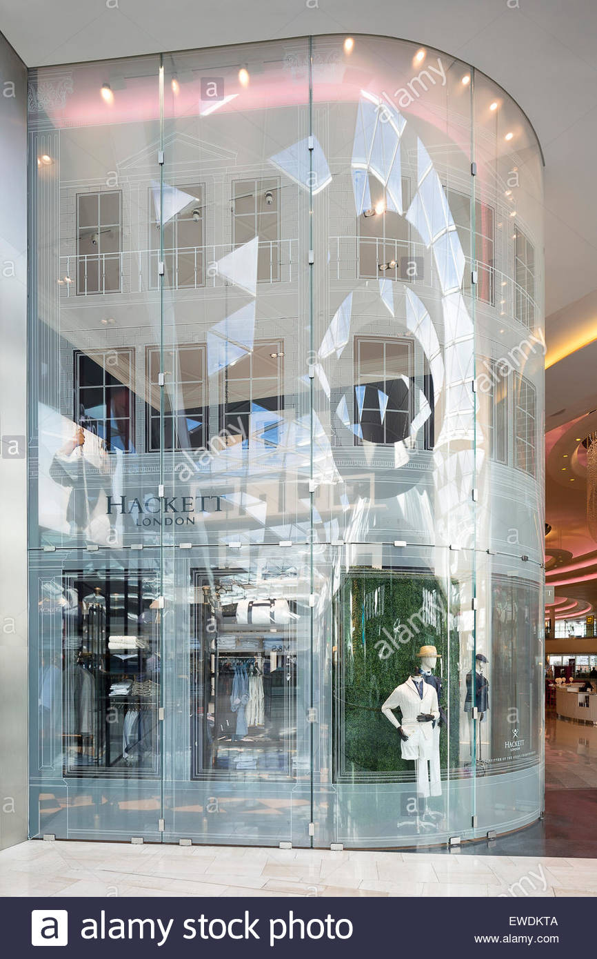 Shop exterior side view. Hackett London, Westfield, London, United Kingdom. Architect: Hackett In-House Team, 2015. - Stock Image